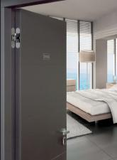 Samozamykający zawias Eclipse Self marki AGB dystrybuowany przez firmę AGAS  - cisza i komfort.